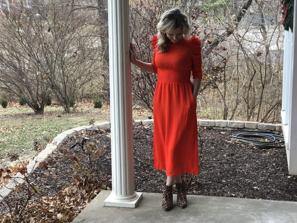 top 3 festive holiday outfits featured by top Missouri fashion blogger, Emmy Lou Styles: image of a blonde woman wearing an H&M red dress and leopard booties