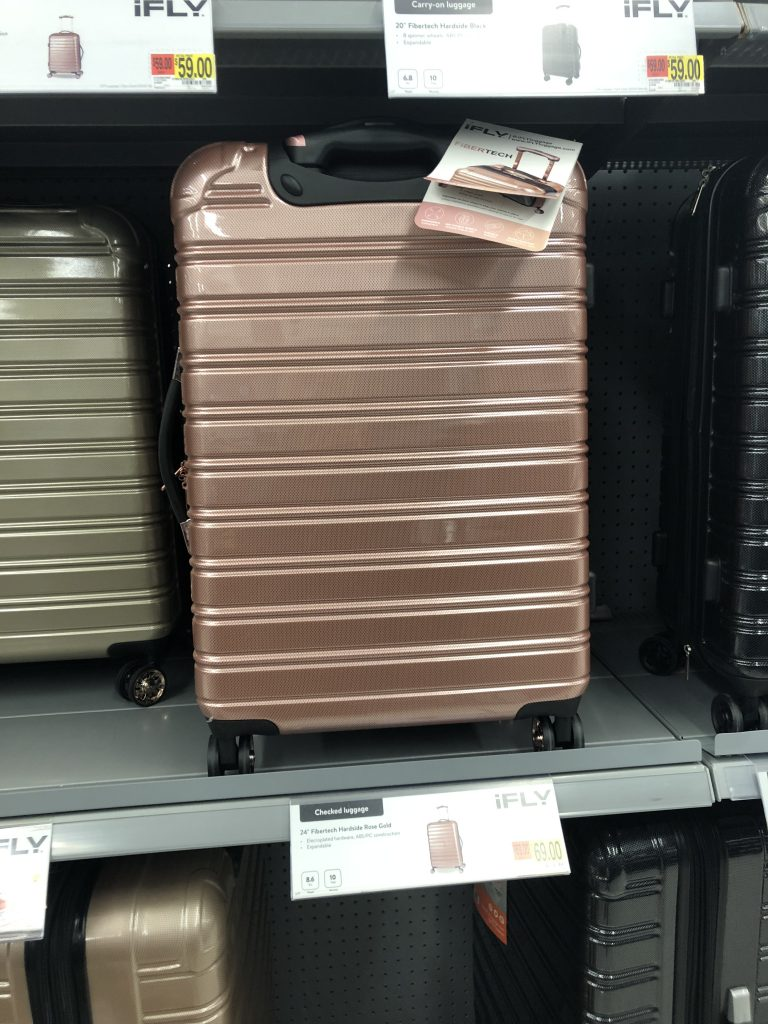 rose gold hard shell suitcase  | The Best Walmart Purchases: 20 Things you Won't Believe are from Walmart featured by top Missouri fashion blogger, Emmy Lou Styles