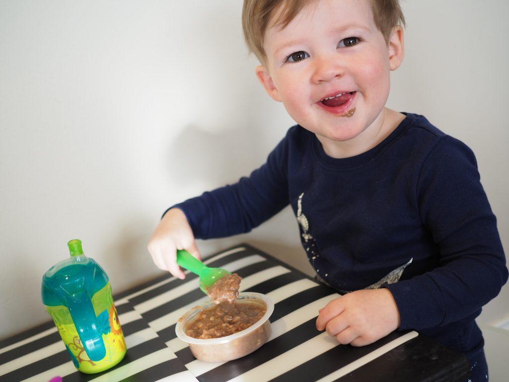 toddler eating happy tot super morning bowl