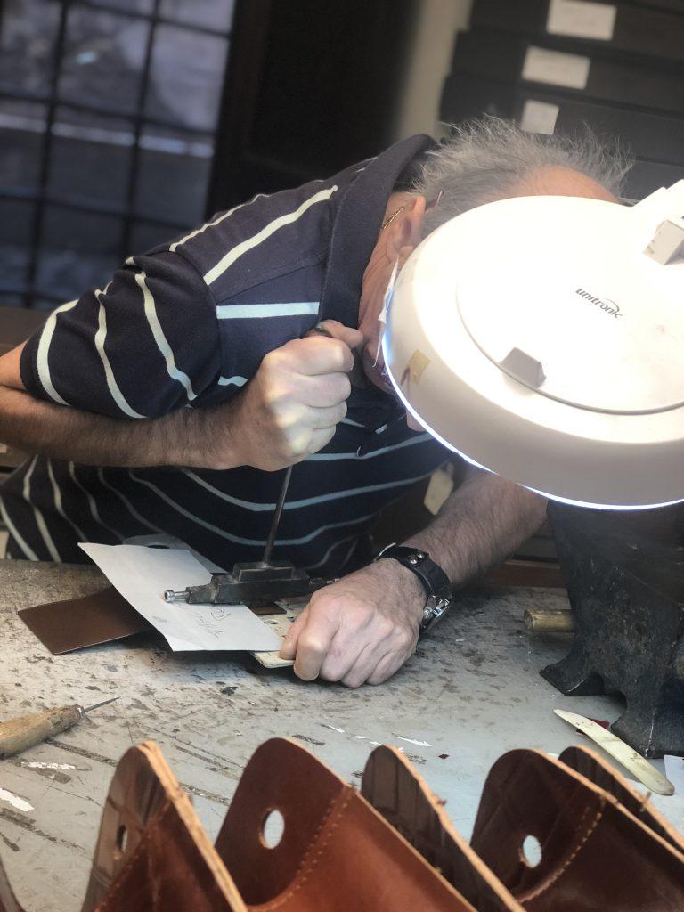 Aldo from Laboratorio Pelletteria hard at work in his leather shop