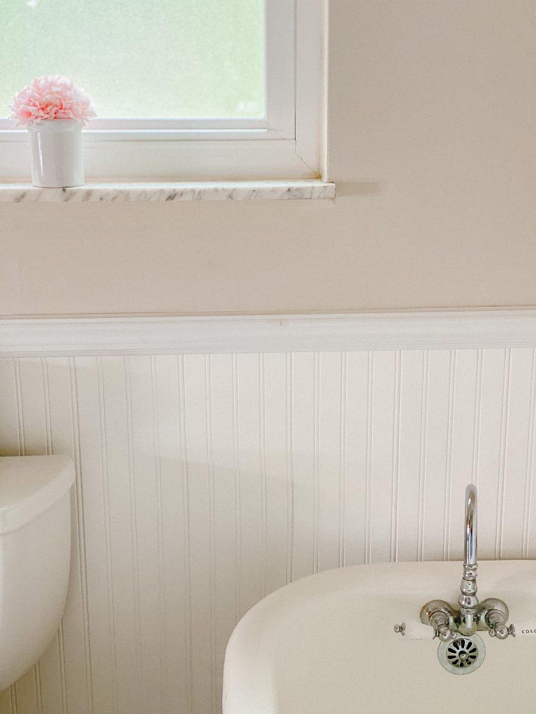 Threshold faux pink flower arrangement for simple bathroom update