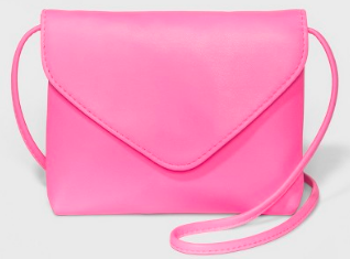 Cute Valentines Day Essentials featured by top US fashion blogger, Emmy Lou Styles: image of a pink crossbody purse