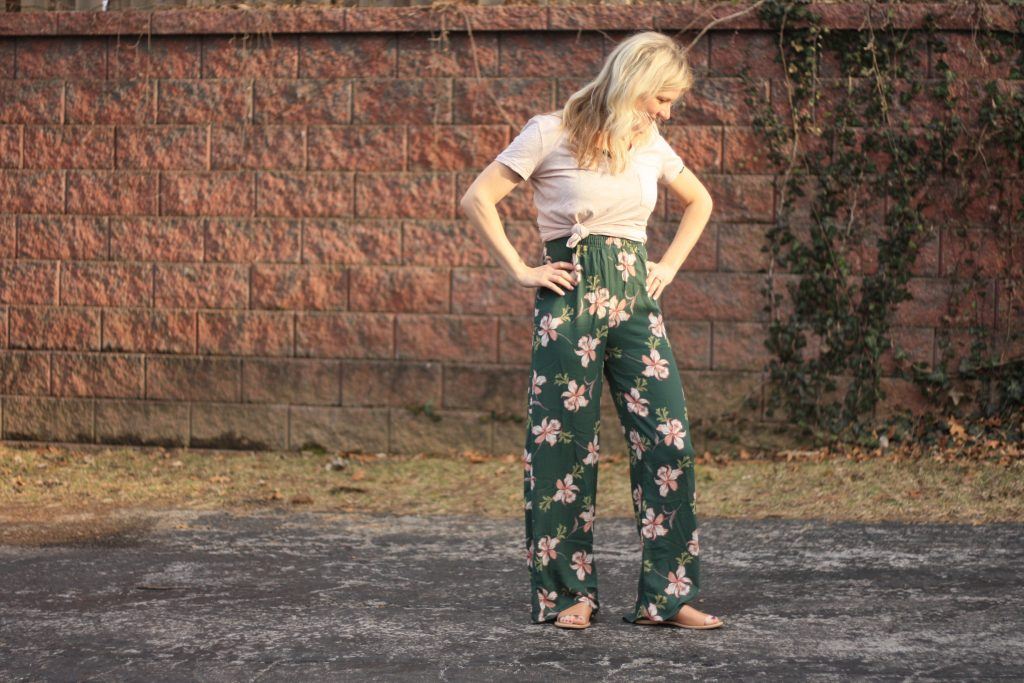 women's jumpsuit with a t-shirt over it | 3 Jumpsuit styling tips featured by top US fashion blogger, Emmy Lou Styles: image of a blonde woman wearing a floral off the shoulder jumpsuit and a plain cotton tee