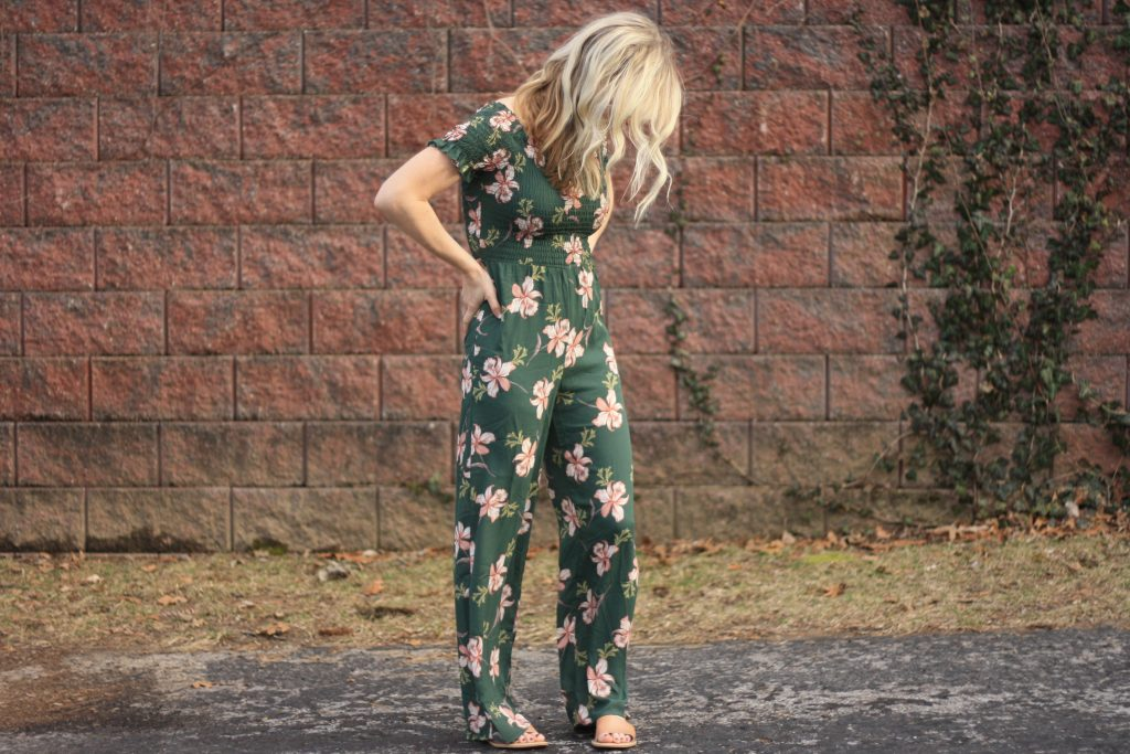 womens green floral flowy jumpsuit | 3 Jumpsuit styling tips featured by top US fashion blogger, Emmy Lou Styles: image of a blonde woman wearing a floral off the shoulder jumpsuit