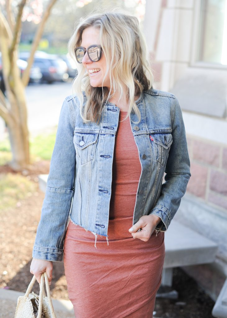 leith body con dress with denim jacket over it | How to style your Leith Ruched Dress featured by top Missouri fashion blogger, Emmy Lou Styles: image of a blonde woman wearing a Leith ruched dress, long cardigan and flat sandals