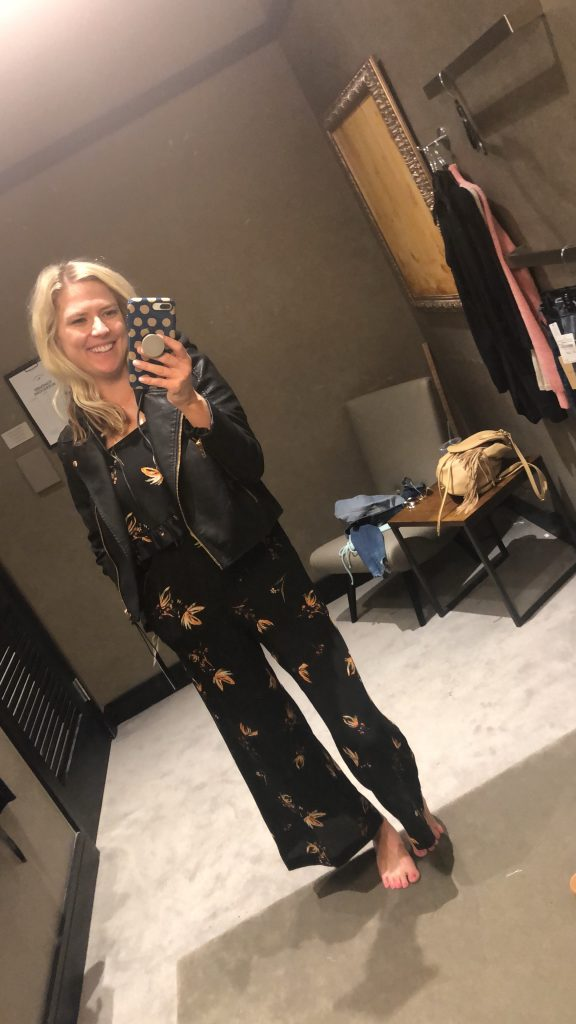 womens black moto jacket | | Top Missouri fashion blogger, Emmy Lou Styles, features her Top Nordstrom Sale Picks: picture of a blonde woman wearing a black motto jacket and a floral jumsuit