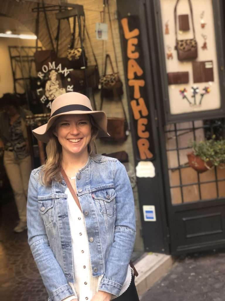 Emily from Emmy Lou Styles purchases leather bag from Laboratorio Pelletteria in Rome, Italy