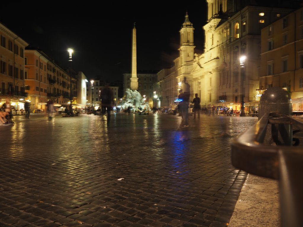 A photo of the Piazza Navona at night.