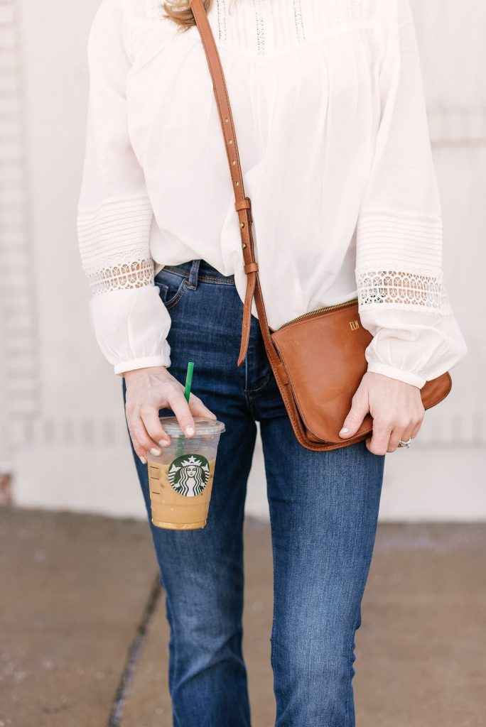 Emily from Emmy Lou Styles life and style blog shares how to style a while blouse with Madewell crossbody bag.