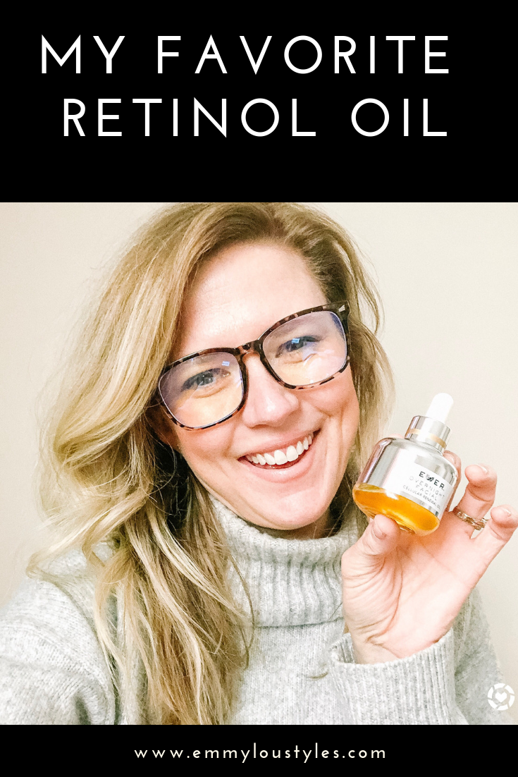 Retinol Oil by EVER Skin reviewed by top US beauty blog, Emmy Lou Styles: Image of woman holding bottle of retinol oil.