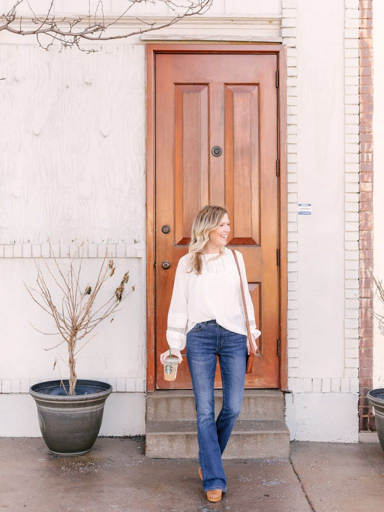 Emily from Emmy Lou Styles life and style blog shares how to style a white blouse in spring.