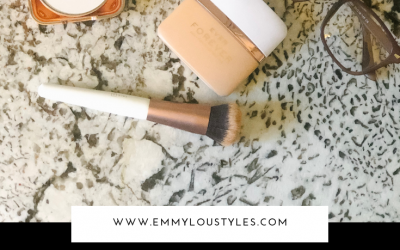 Ever Daily Face Foundation in Light Natural. image of ever skin blur powder and foundation sitting on granite counter top