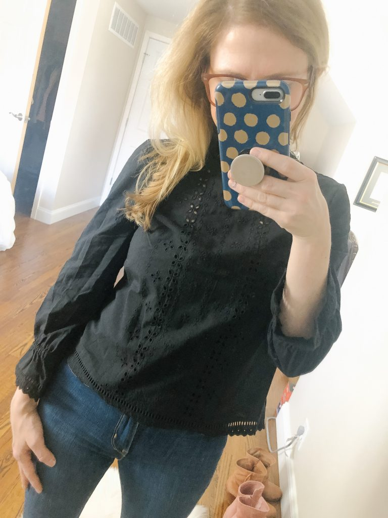 H&M black eyelet blouse. image of woman wearing black eyelet blouse in front of a mirror taking a picture.