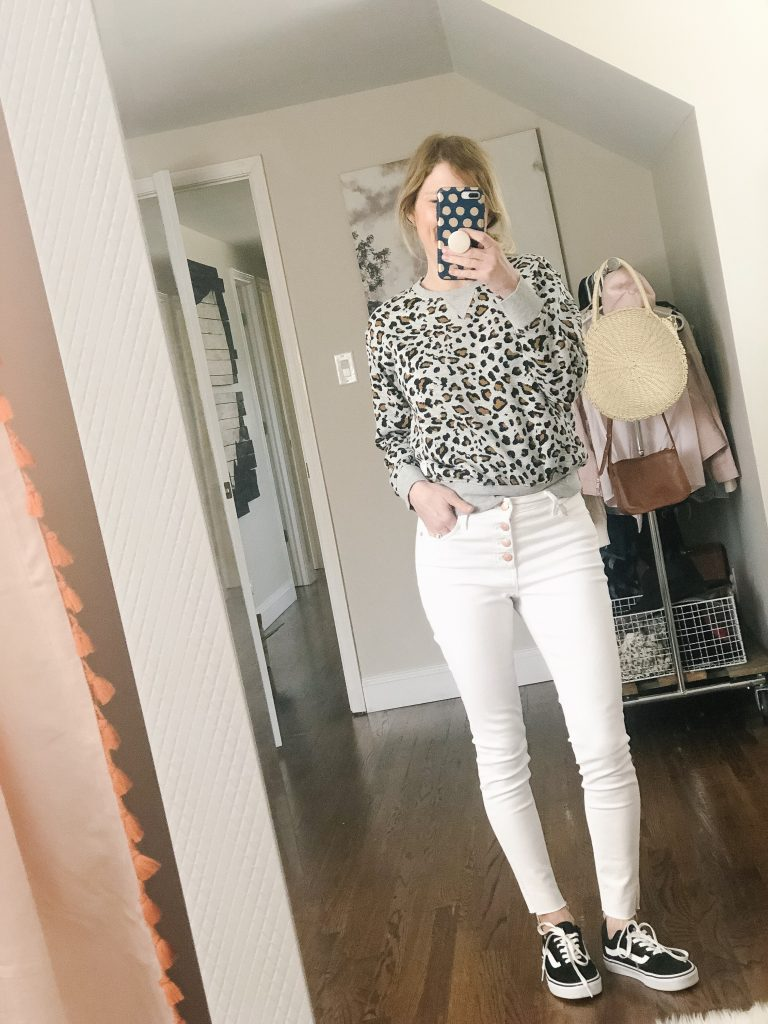 7 ways to wear white jeans_woman wearing leopard print sweatshirt with white jeans