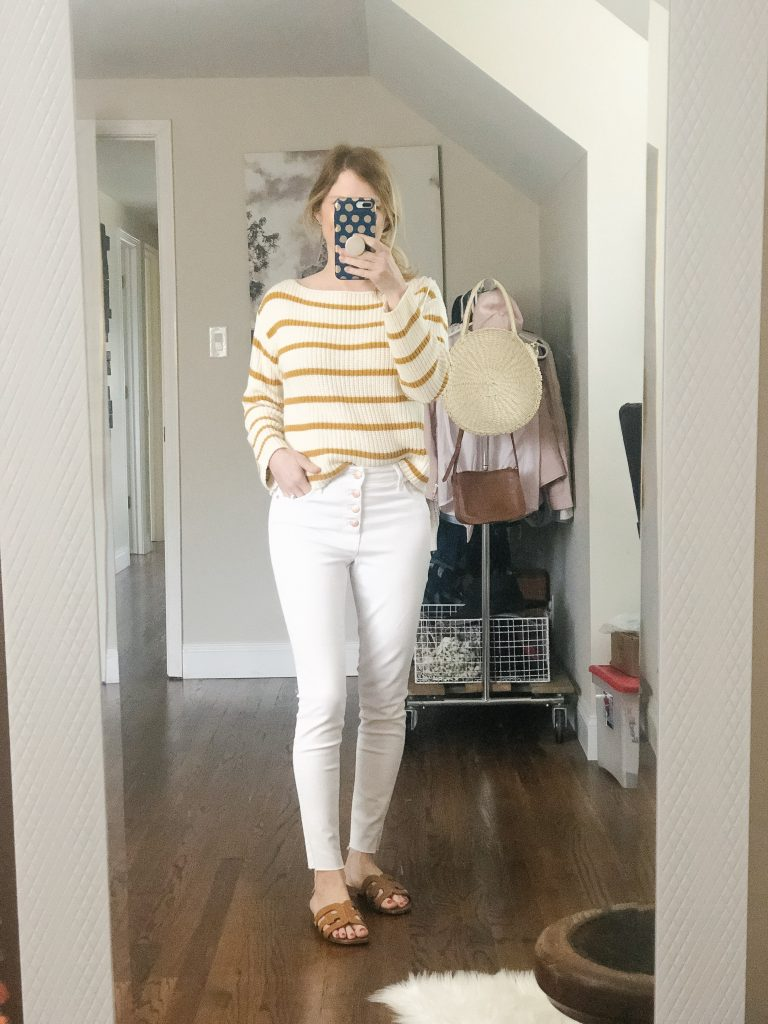 7 ways to wear white jeans_woman wearing spring sweater with white jeans