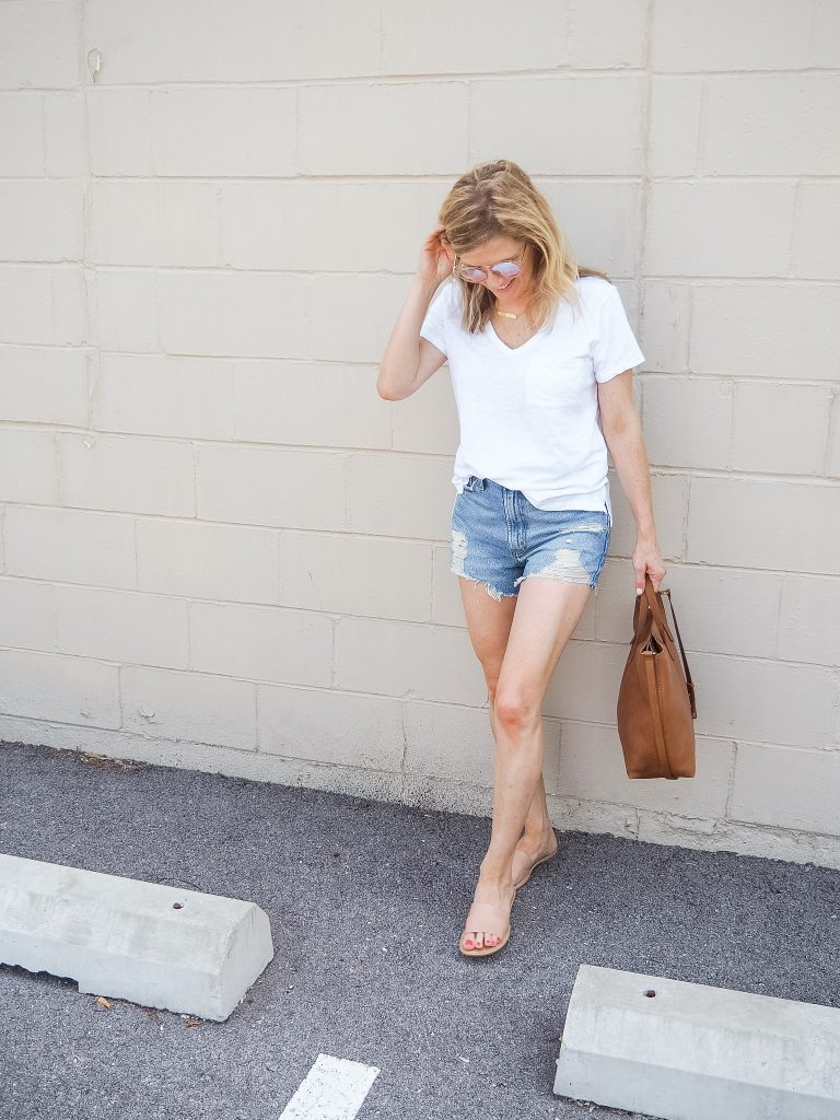 Casual mom wearing denim shorts and a white tshirt_Friday Favorites summer must haves