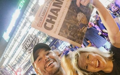 St Louis Blues Stanley Cup Champs_couple poses outside of Enterprise center