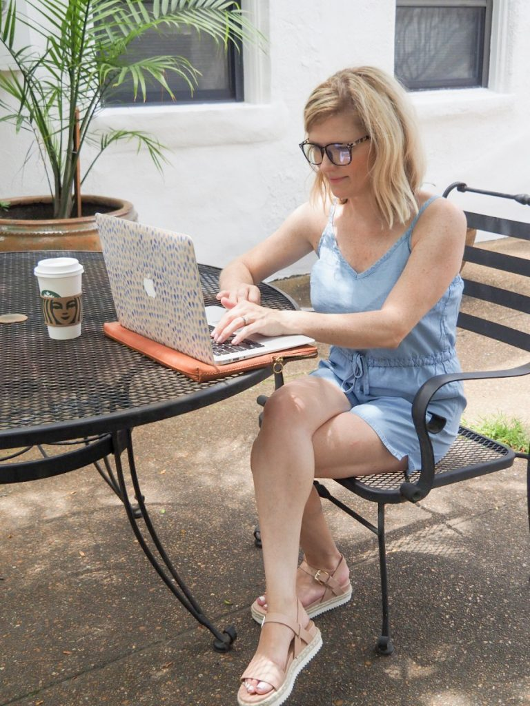 Women sitting outside working on laptop