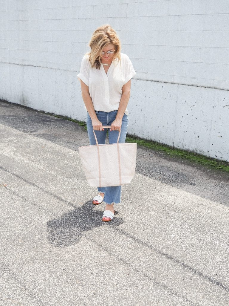 You Own The Look_girl showing straw tote
