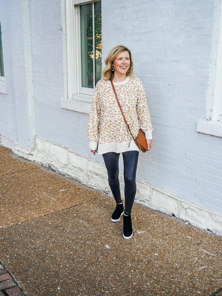 Friday Favorites: Woman wearing leopard sweatshirt with black sneaker booties