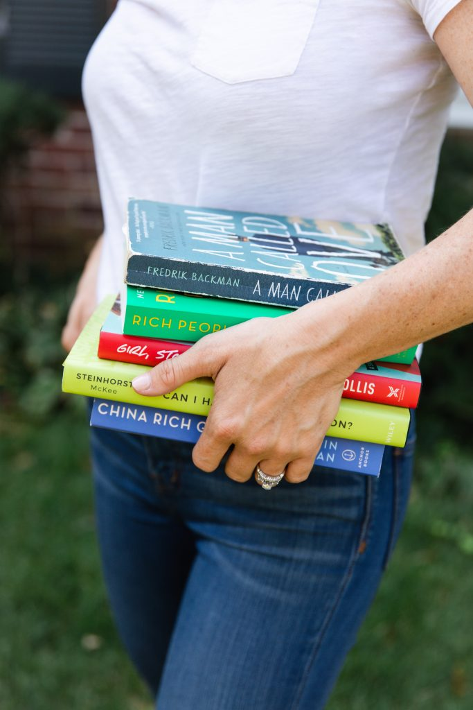 5 Ways to Start Reading More_woman holding stack of book