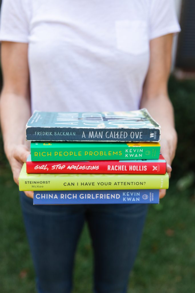 5 Ways to Start Reading More_woman holding stack of books
