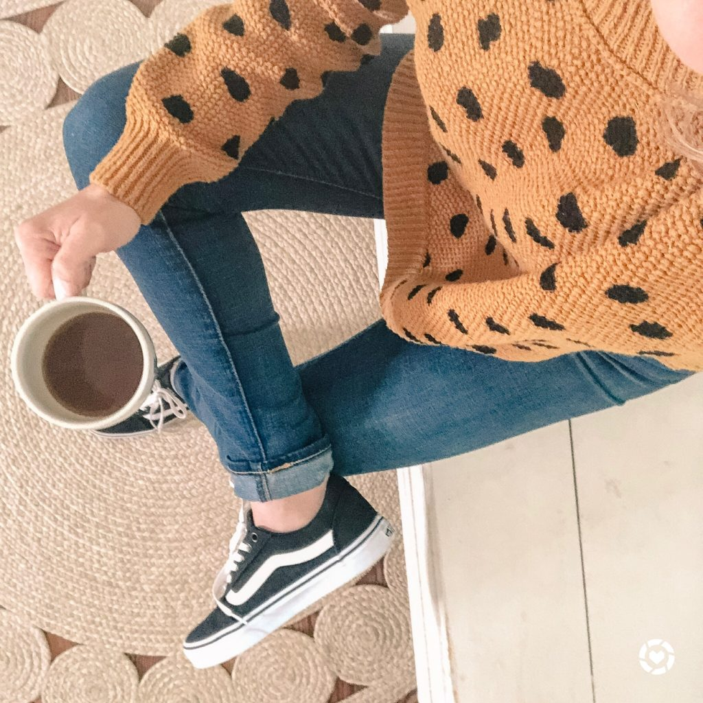 girl wearing madewell sweater with polka dots and black vans sneakers