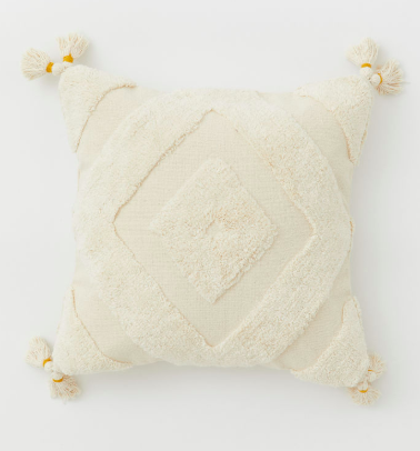 offwhite cableknit throw pillow with tassels
