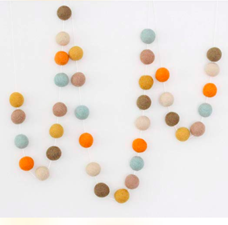 decorative felt pom pom garland in fall color pallette