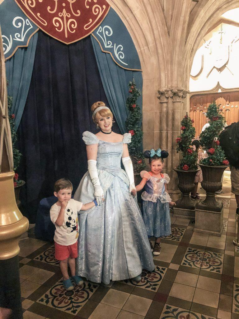 Meeting Cinderella at the entrance to the Royal Table at Disney World