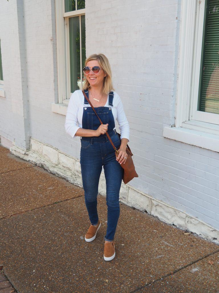 woman wearing denim overalls