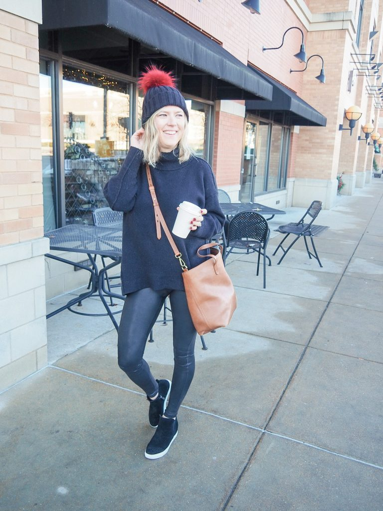 Black faux leather spanx leggings with oversized sweater