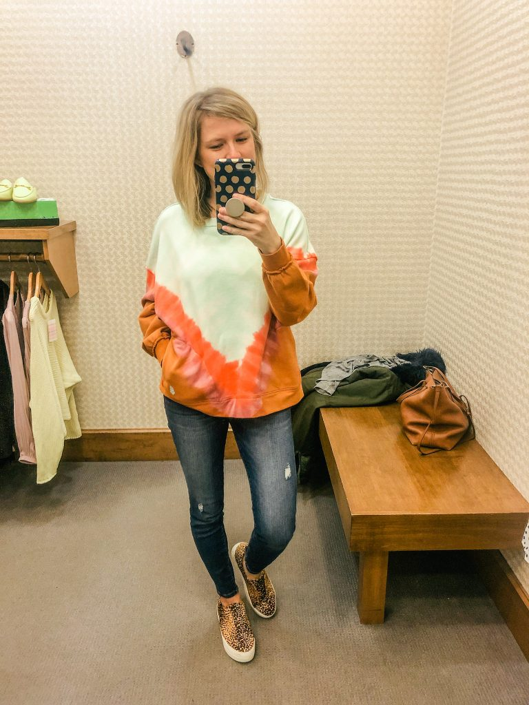 Photo of woman wearing Free People tie dye sweatshirt with pockets from Evereve
