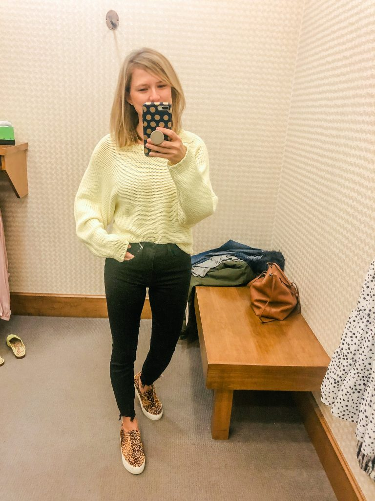 Photo of woman wearing bright yellow spring sweater from Evereve new arrivals