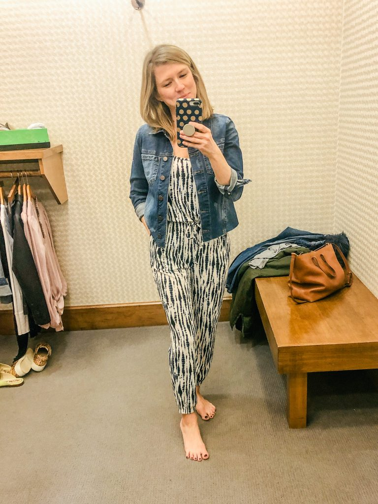 Photo of woman wearing tiedye jumpsuit and denim jacket from Evereve