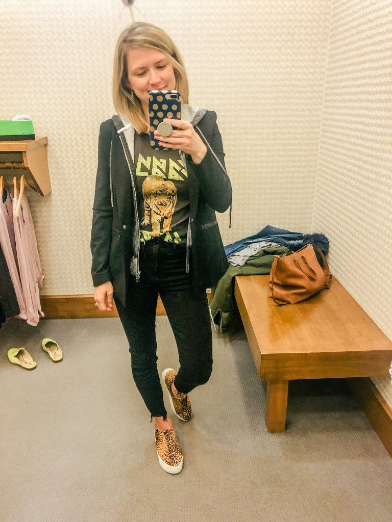 Woman wearing graphic tee and fitted blazer from Evereve standing in front of mirror