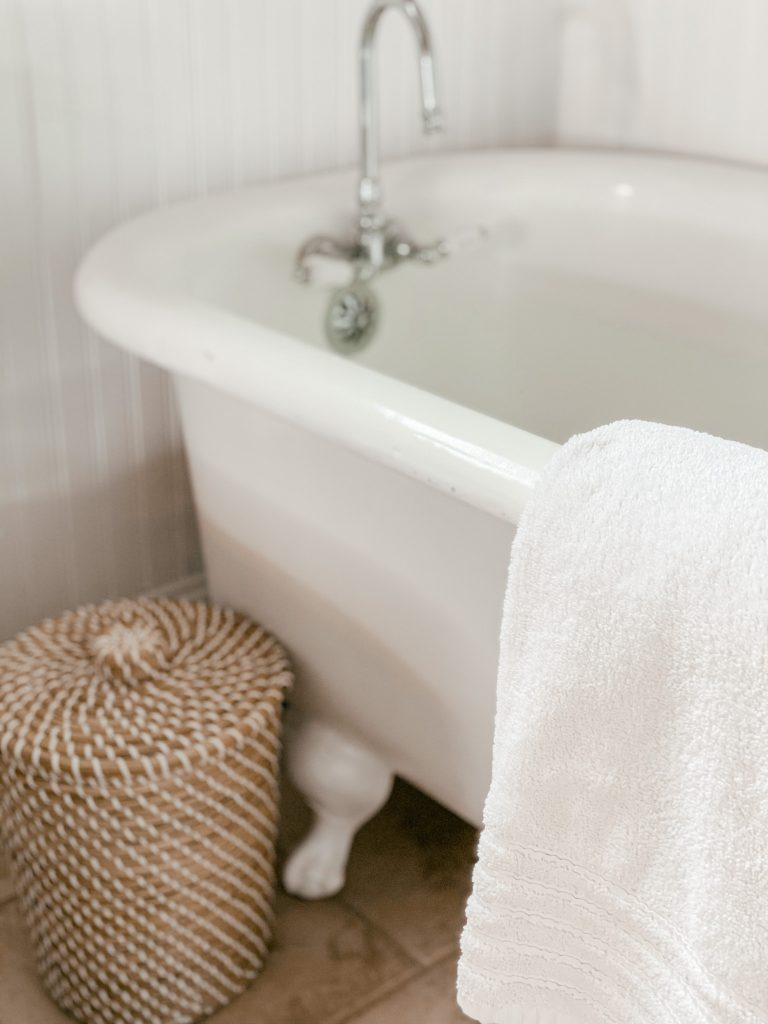 Woven grass wastebasket for simple bathroom update