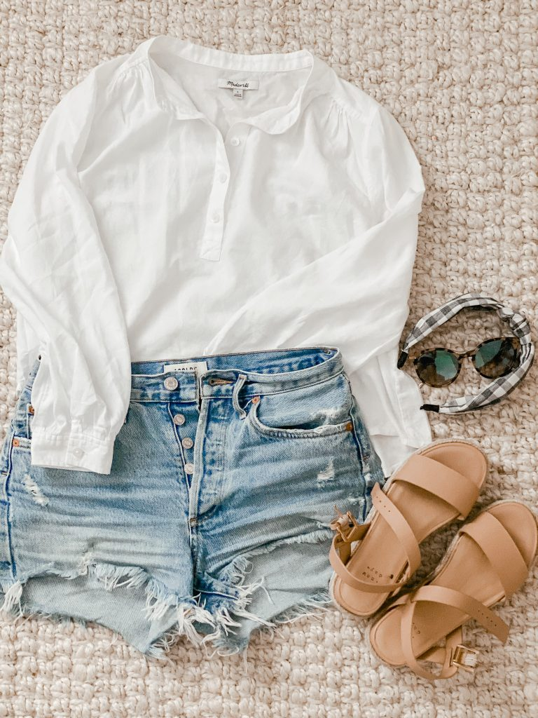 cutoff jean shorts with a white button up blouse and sandals