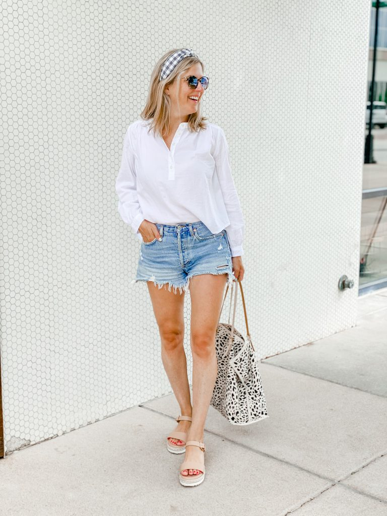 Cutoff jean shorts with a white button up for summer
