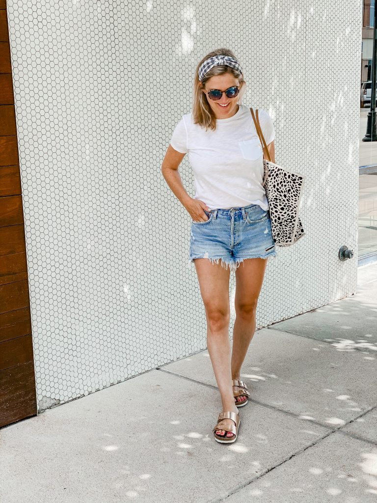 cut off jean shorts with a white t shirt