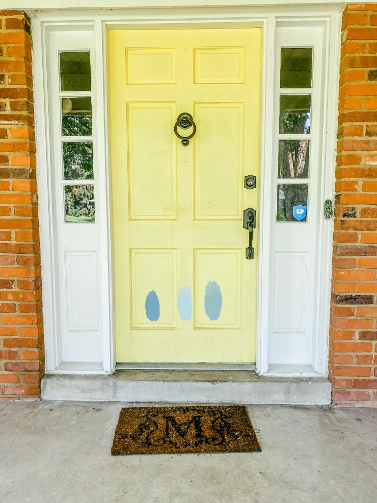 Blue paint swatches for a front door