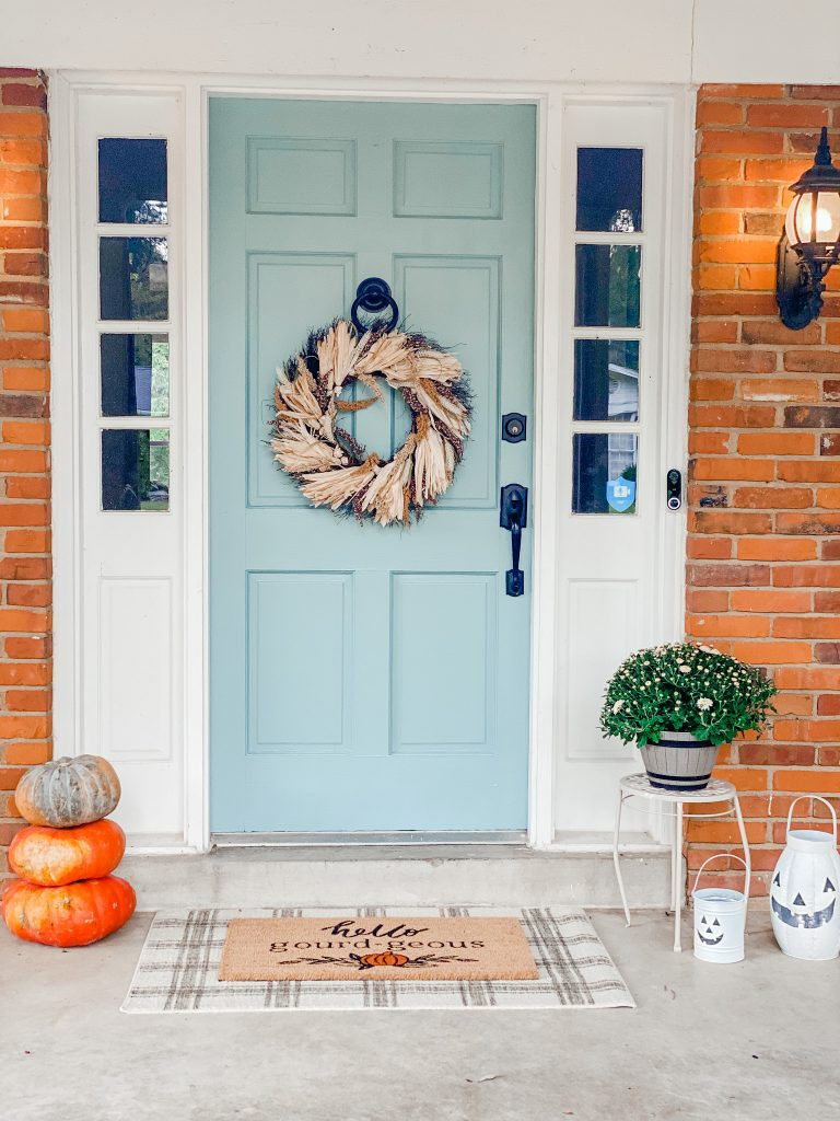 blue front door with fall decor