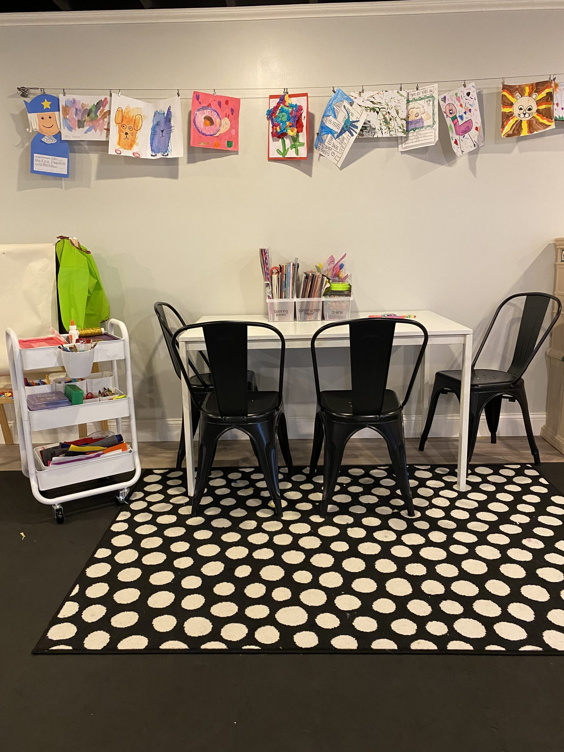 Organized kids playroom with craft table
