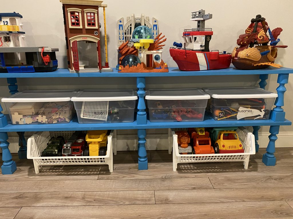 Organized kids playroom with shelving
