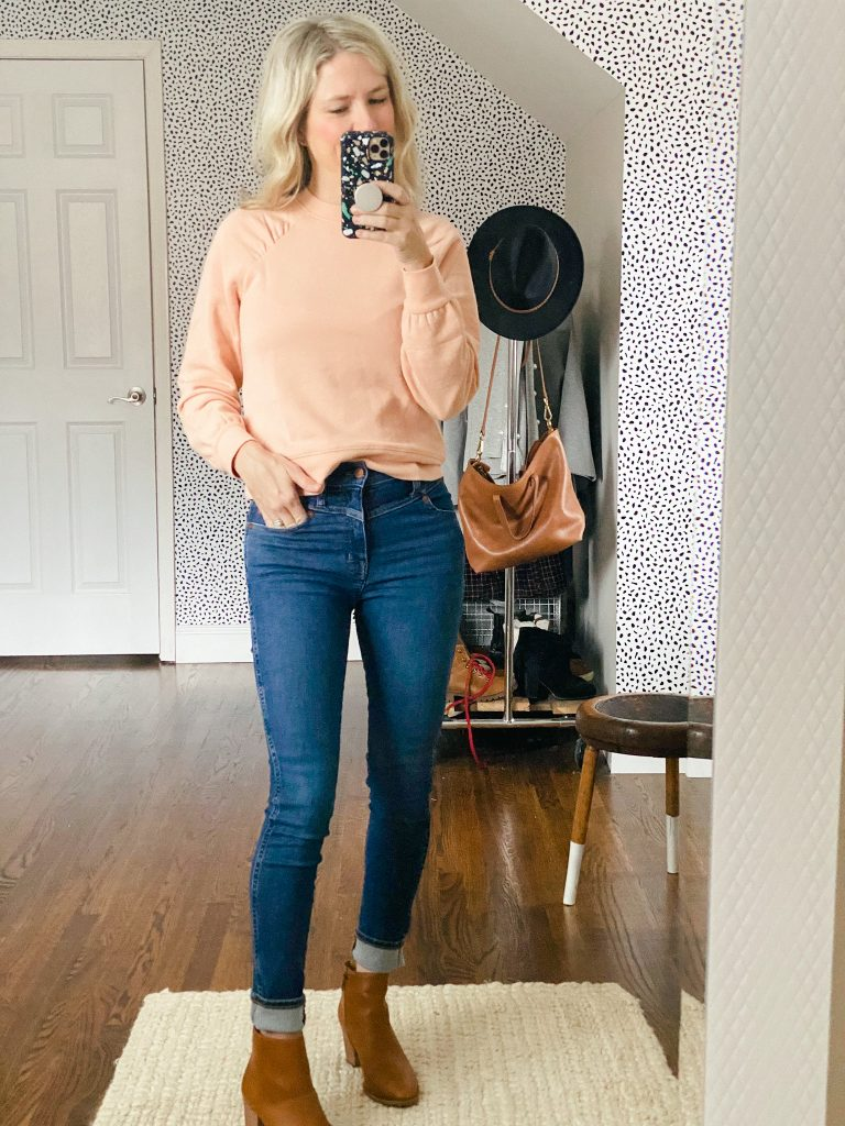 Women wearing Madewell sweatshirt and jeans