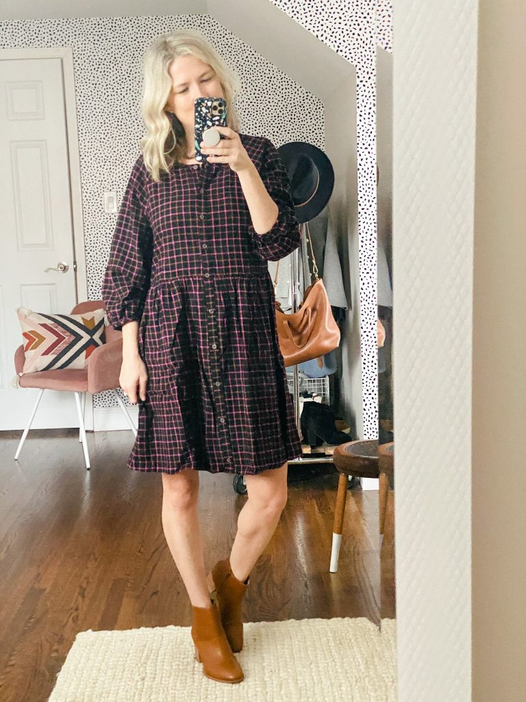 Women wearing plaid Madewell dress and boots