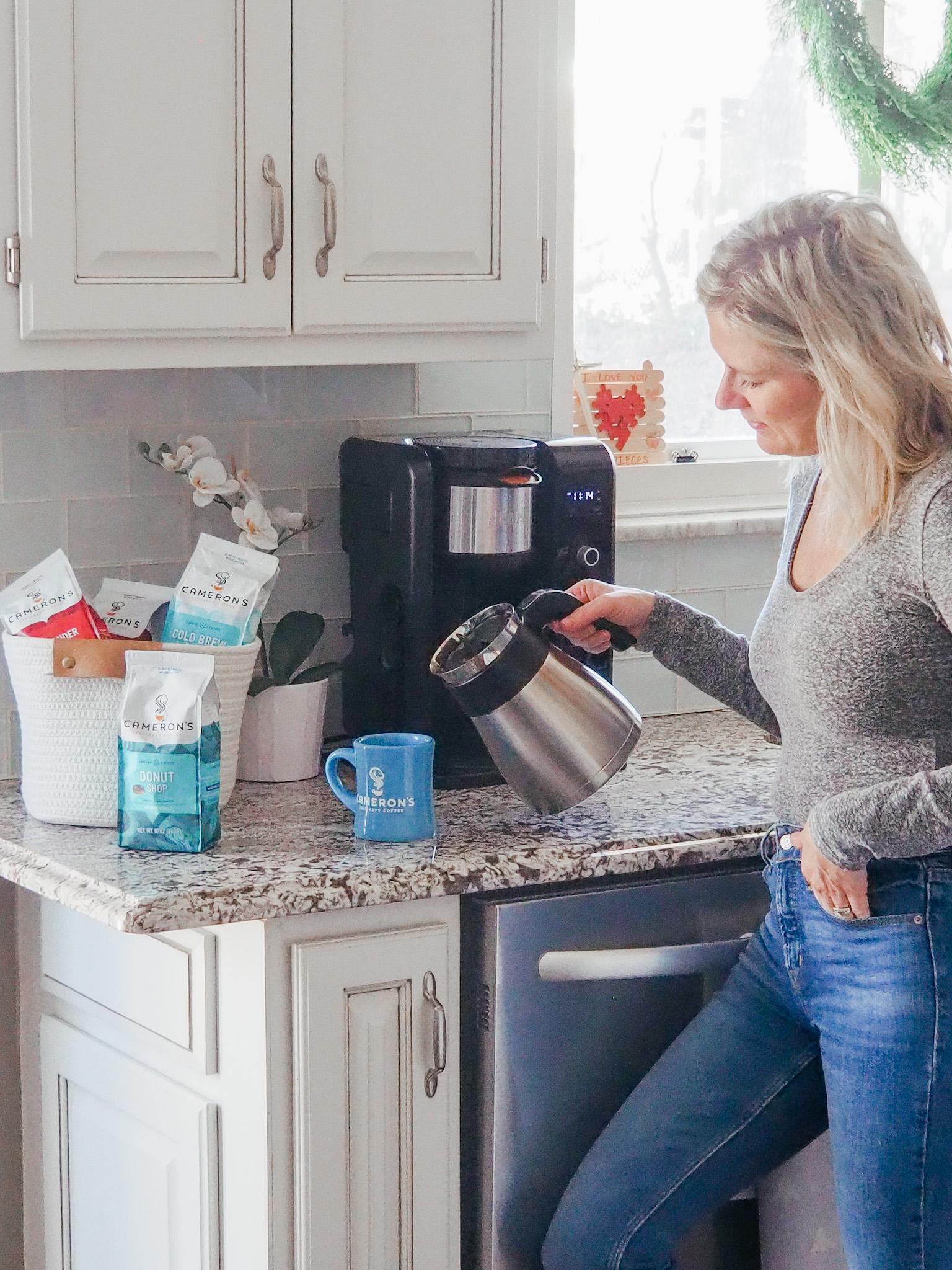 Woman pouring Cameron's Coffee into a mug