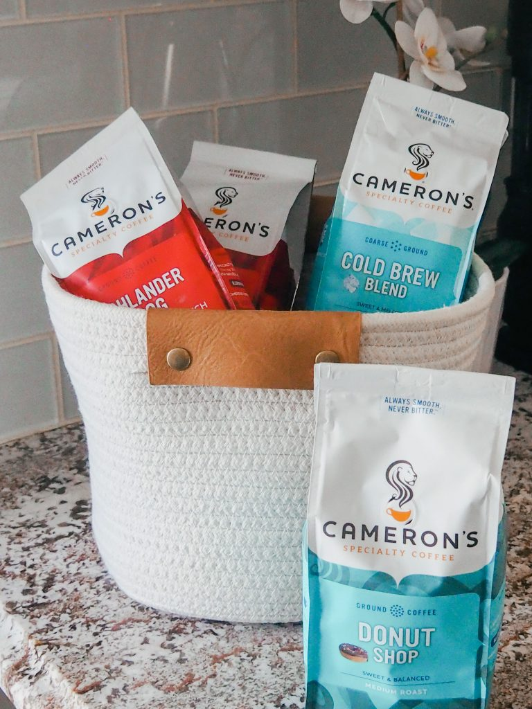 A basket full of Cameron's Coffee sitting on counter