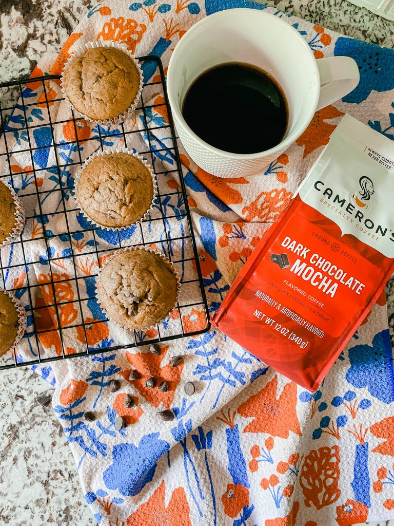 Camerons Dark Chocolate Mocha blend with muffins on cooling rack and coffee cup